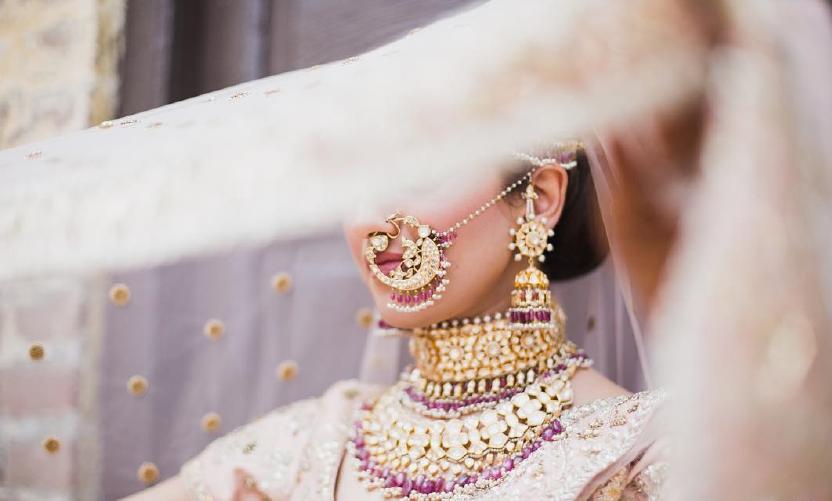 Indian Bride full of heavy jewellery