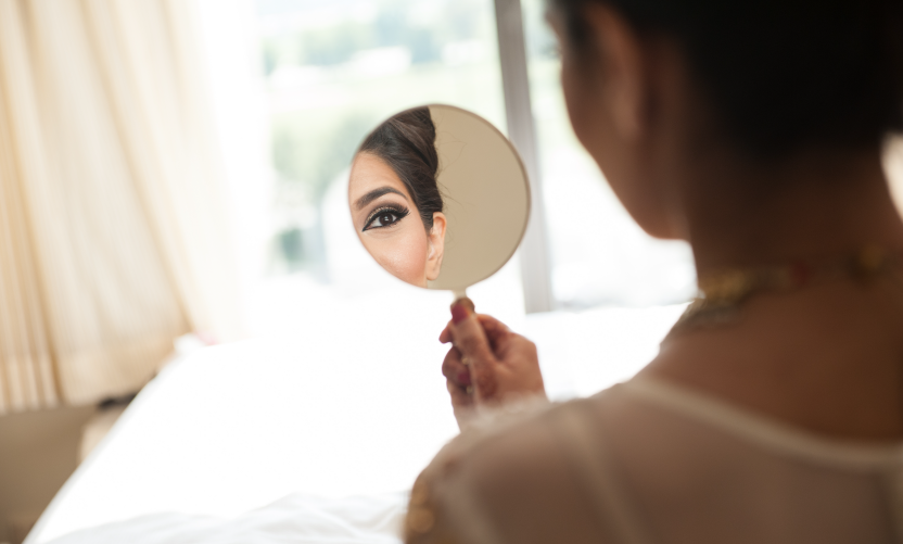 woman-getting-ready-in-front-of-mirror